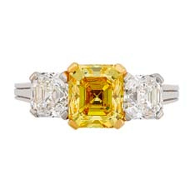 Three stone yellow and white diamond engagement ring