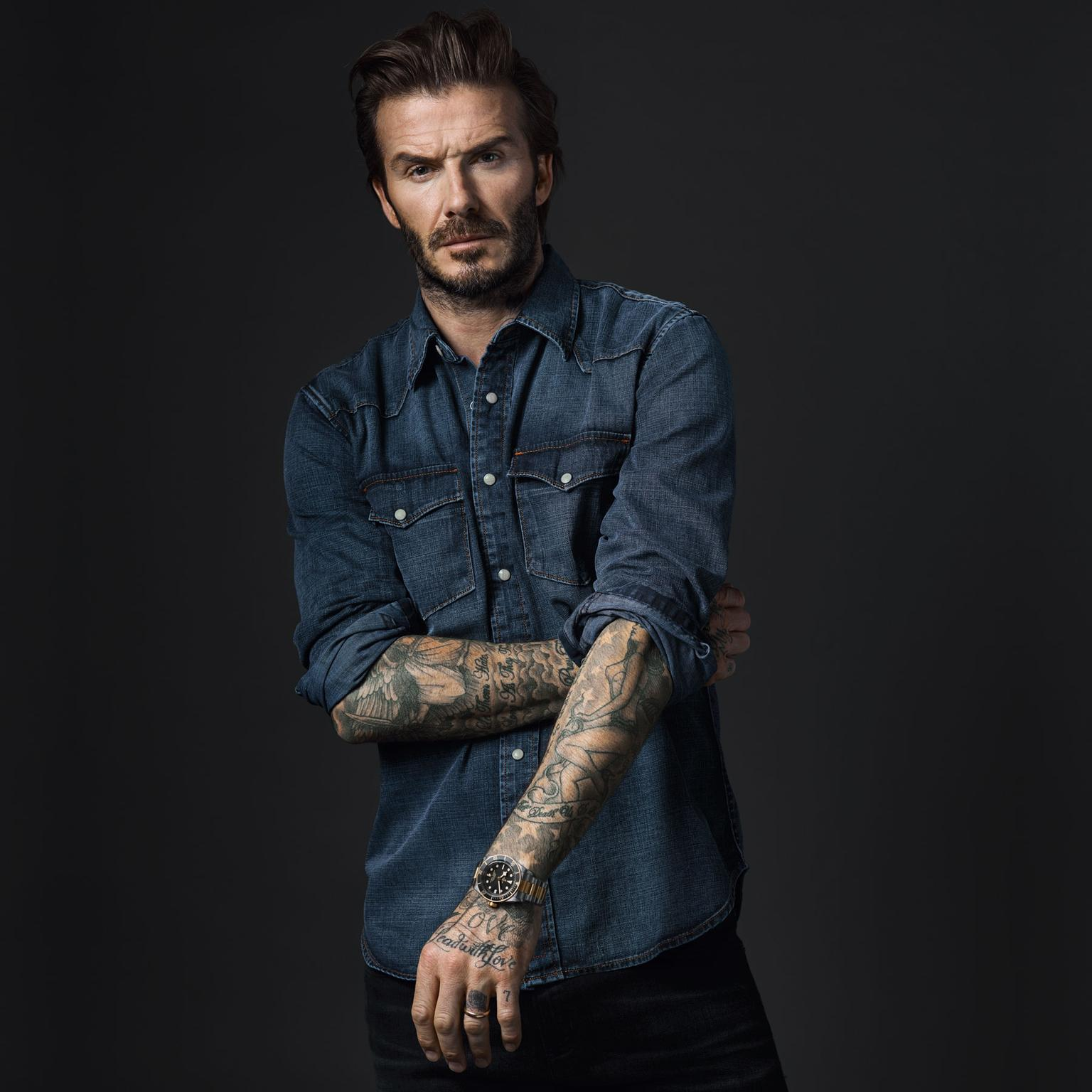 Tudor Born to Dare watch campaign featuring David Beckham in a denim shirt