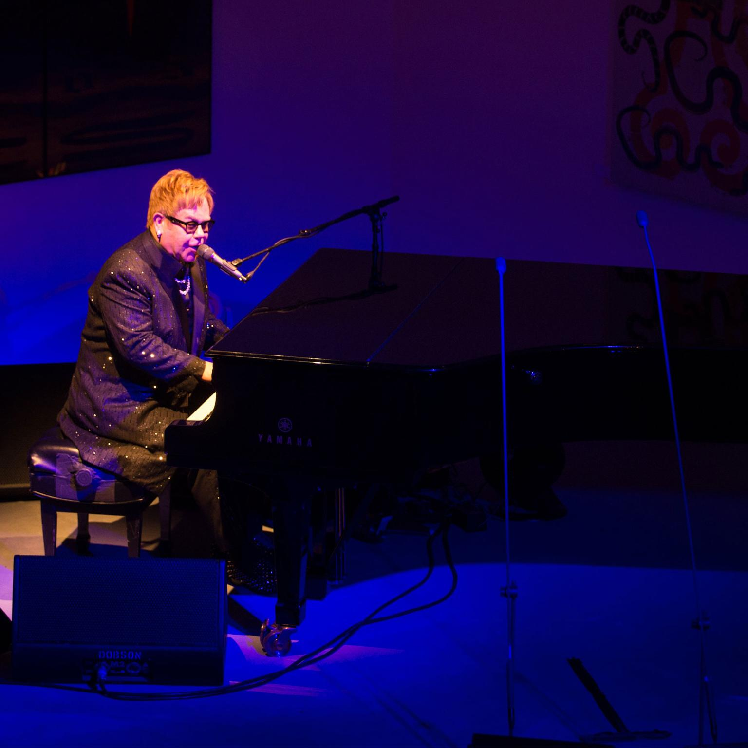 Sir Elton John performing at his AIDS Foundation Dinner