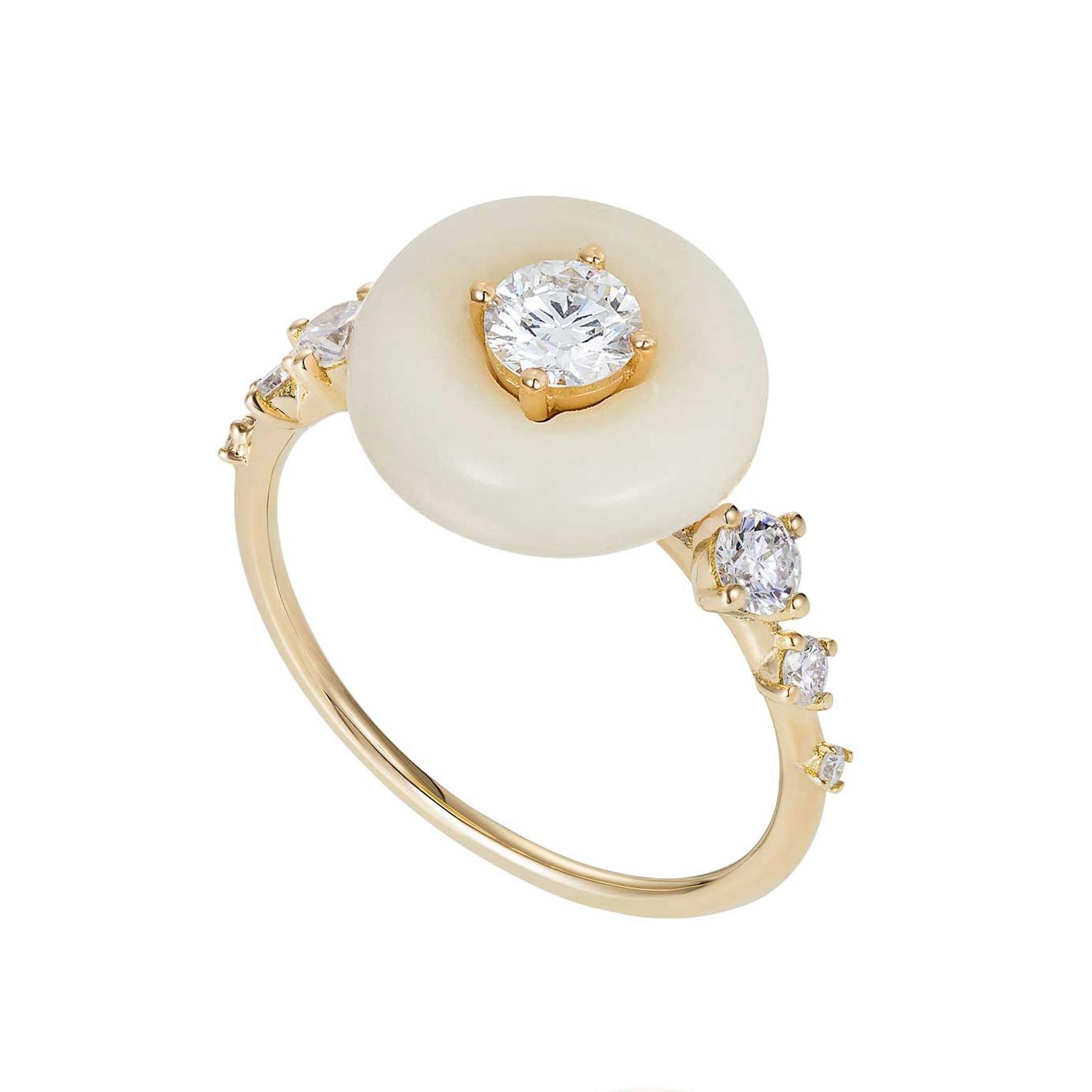Fernando Jorge's Surround Orbit ring places a 0.52-carat diamond inside a plump circle of tagua nut on a dainty yellow gold band.