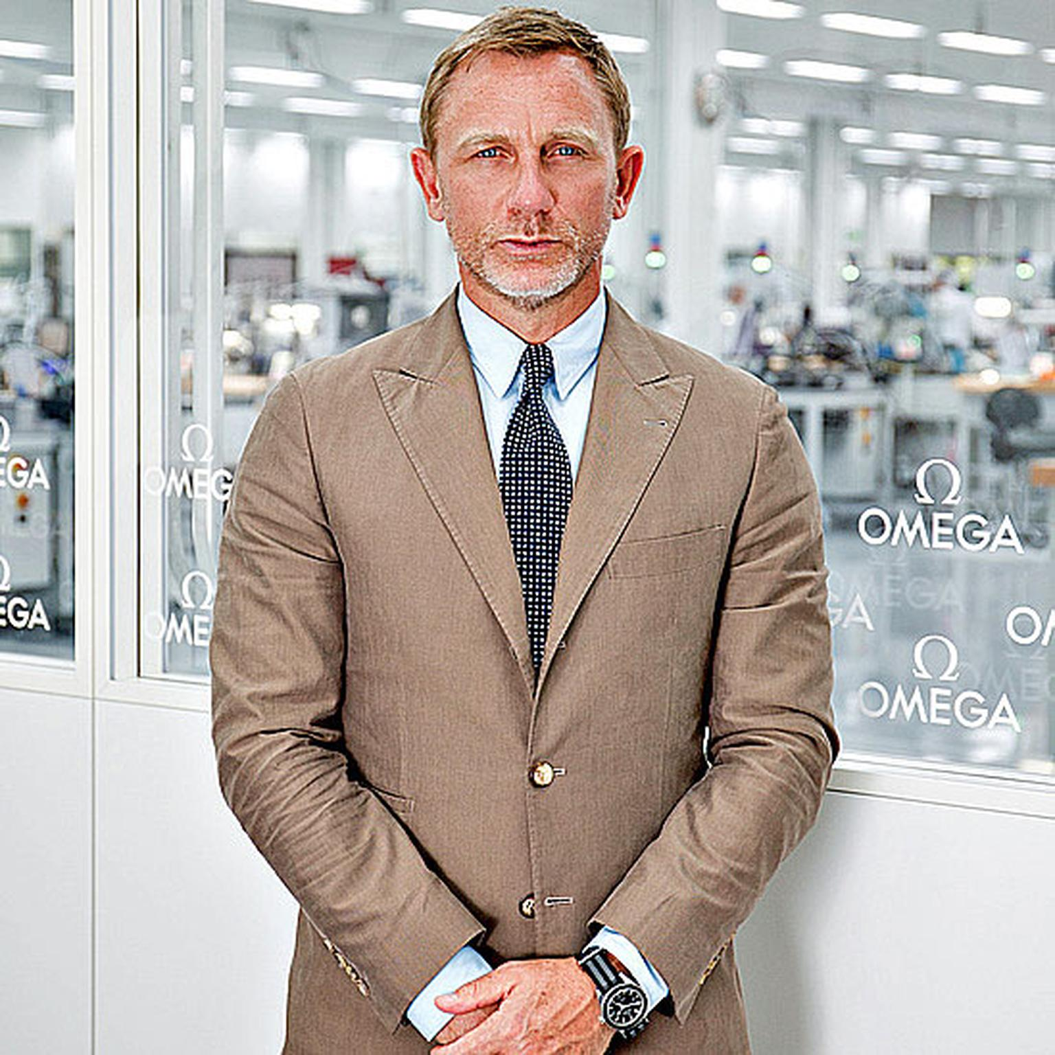 Daniel Craig at Omega manufacture wearing the Omega Seamaster Spectre
