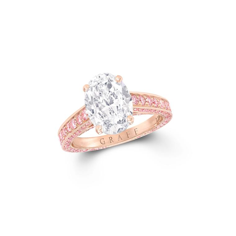 Flame oval diamond engagement ring with pink diamonds