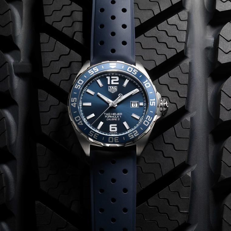 TAG Heuer Formula 1 Bucherer Blue Edition watch on rubber strap on tyre