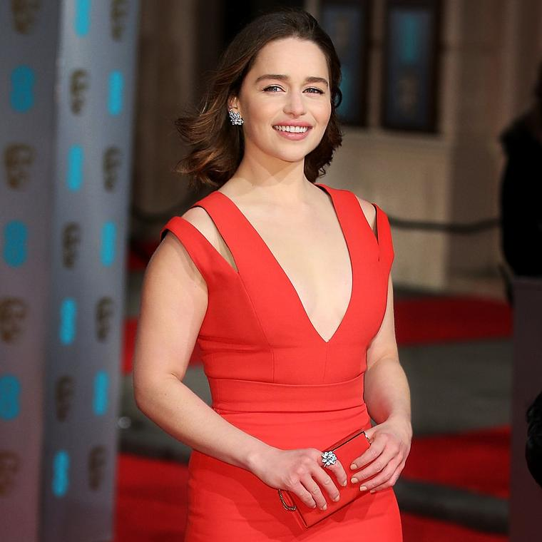 Emilia Clarke wearing Tiffany earrings and ring Baftas