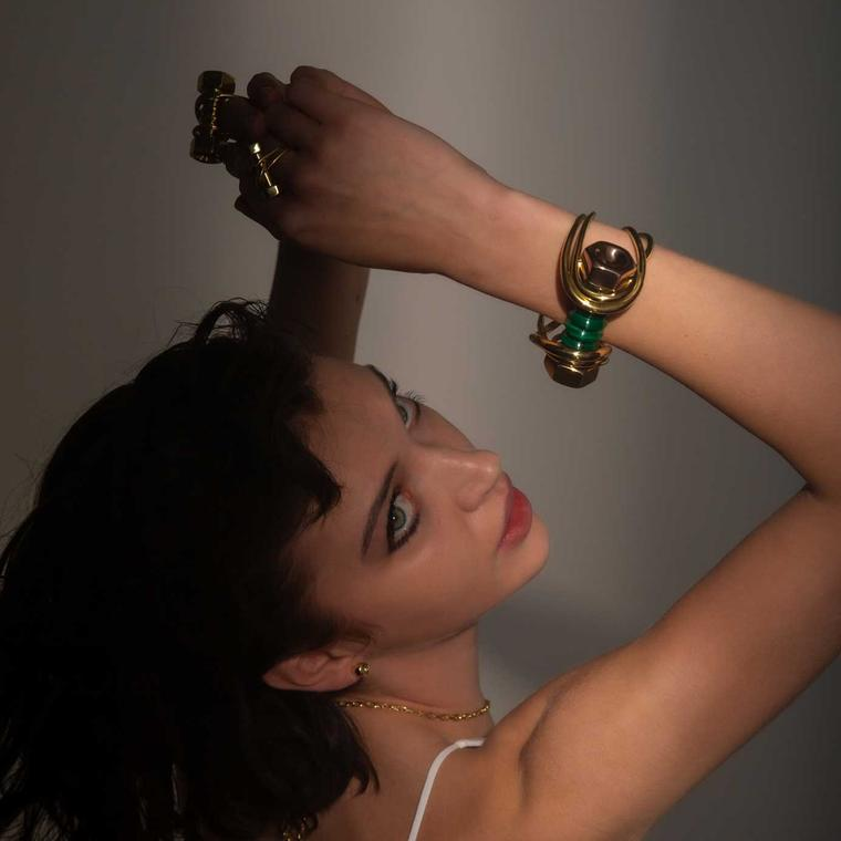 Hannah Martin New Act of Rebellion bolt rings and bracelet on model