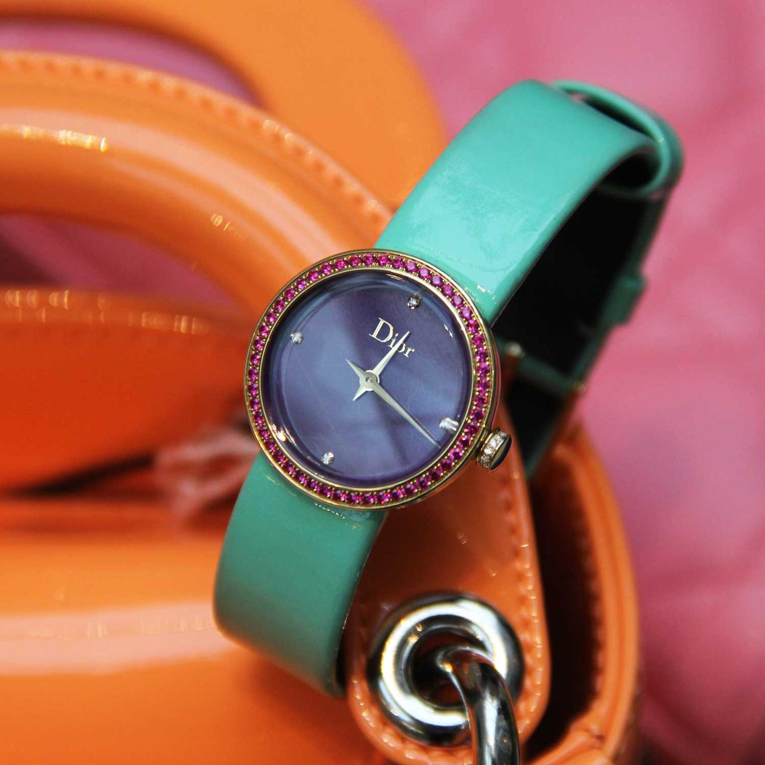 La D de Dior watch with sugilite dial and ruby bezel