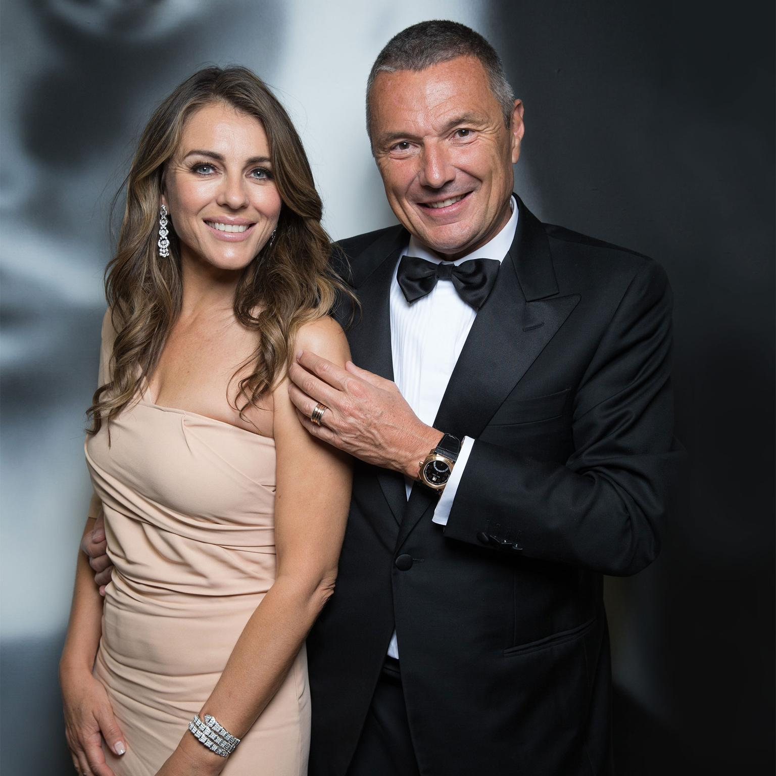 Liz Hurley and Bulgari's Jean-Christophe Babin at Elton John's AIDS Foundation