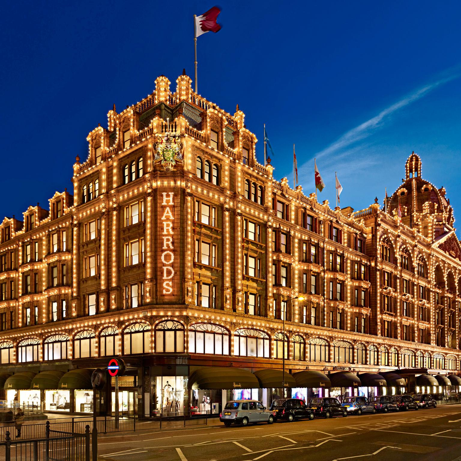 Exterior of Harrods department store at night