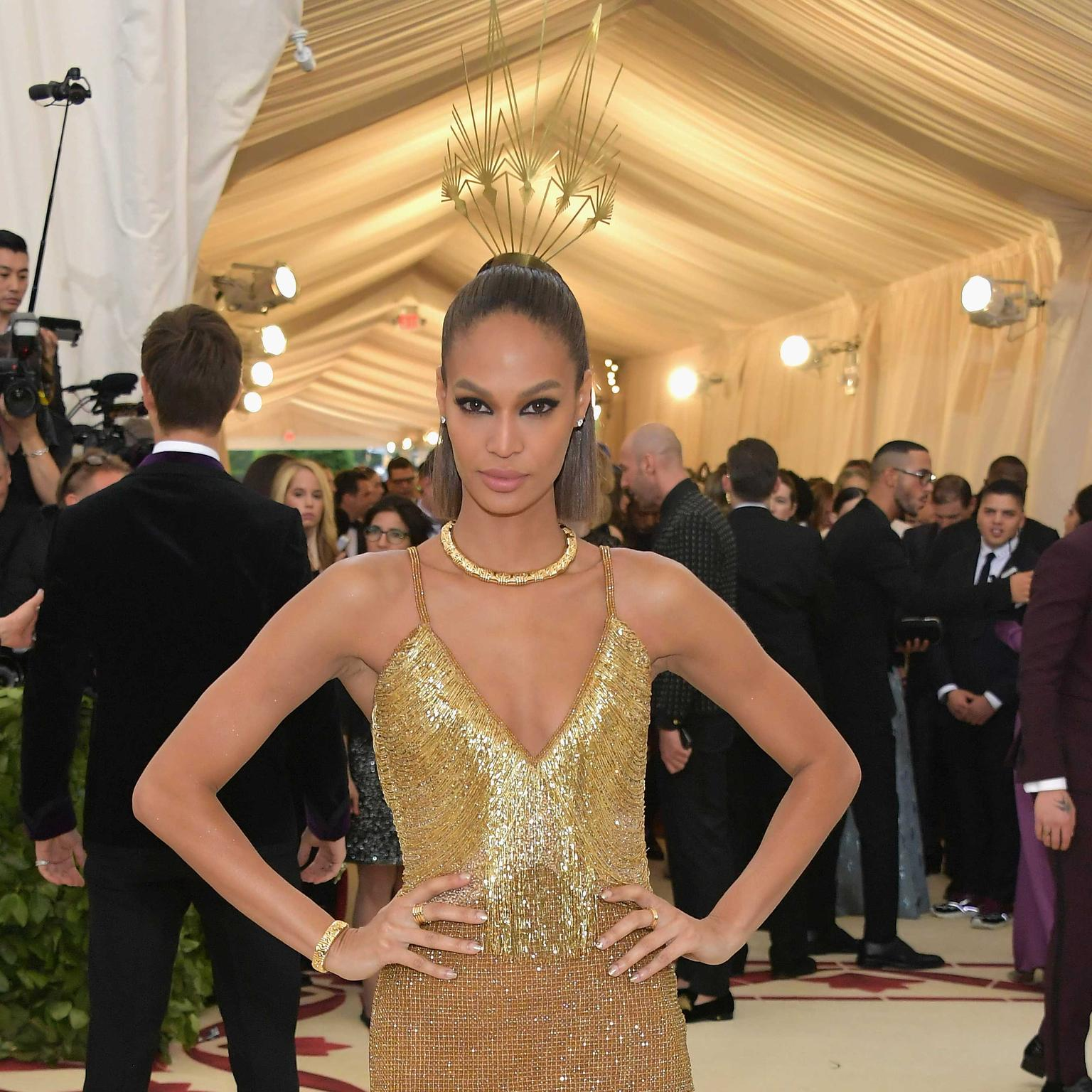 Joan Smalls in Bulgari Parentesi Heritage necklace and bracelet in yellow gold at Met Gala 2018. Credit: Getty Images