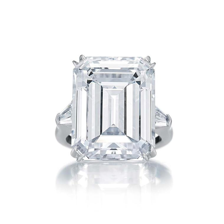 Harry Winston Classic Winston emerald-cut diamond engagement ring in platinum with tapered baguette side stones.