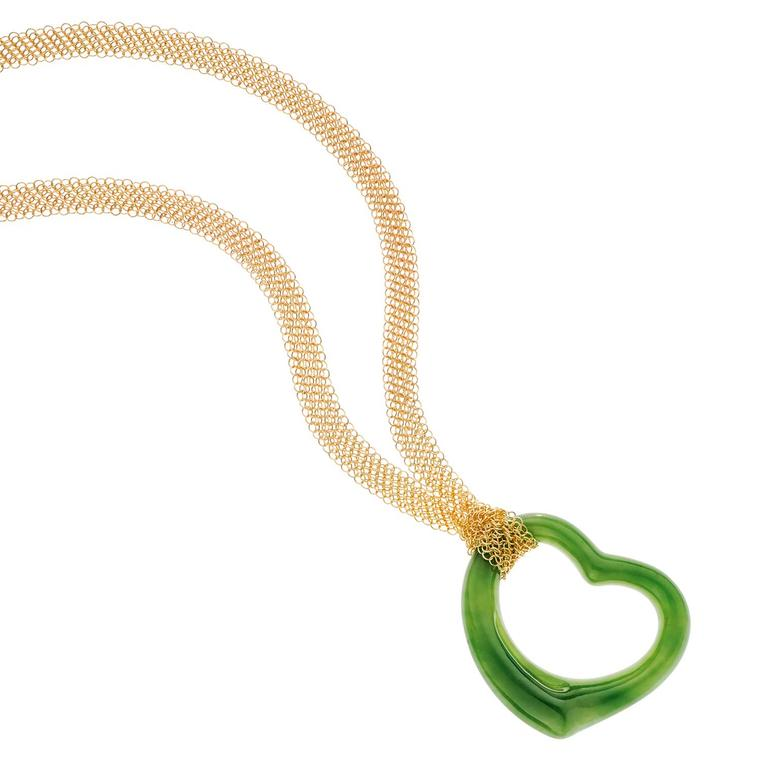 Elsa Peretti Open Heart green jade pendant on a gold mesh chain
