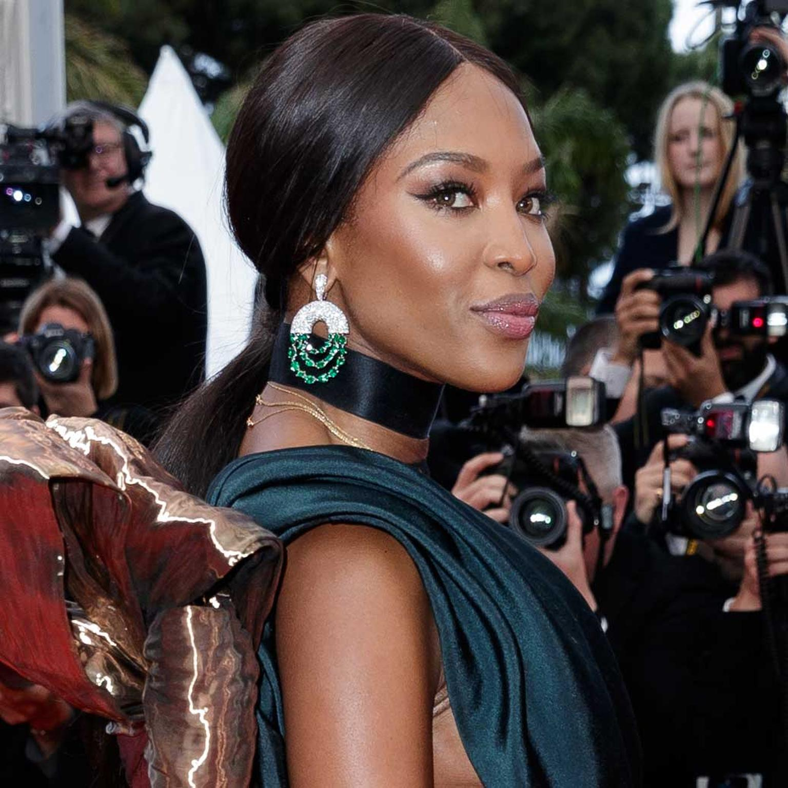 Naomi Campbell in De Grisogono emerald earrings on Cannes Red Carpet 2018