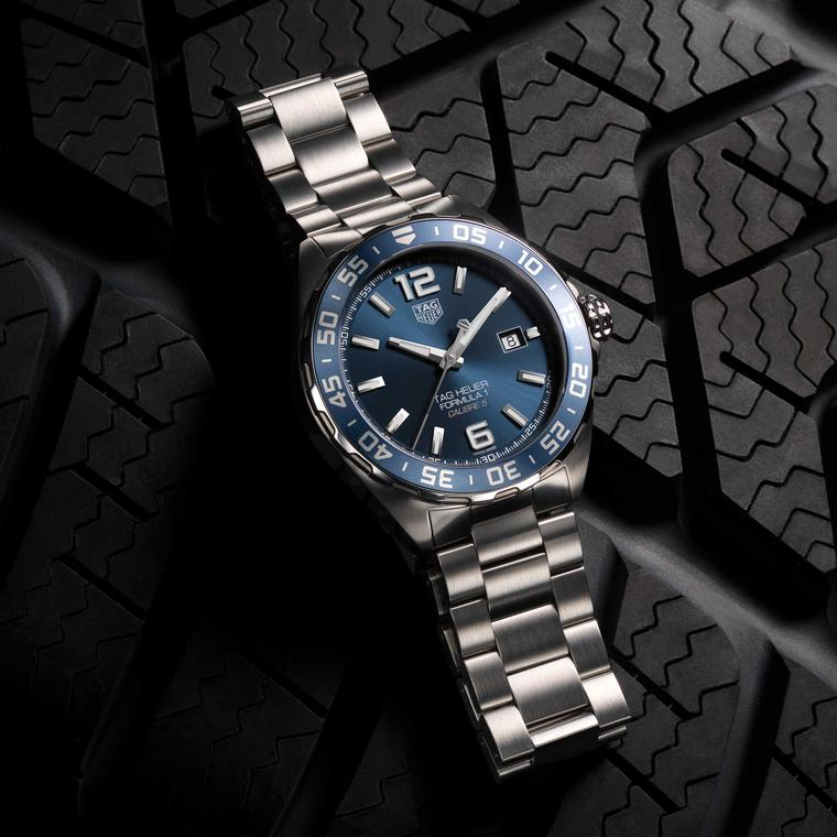 TAG Heuer Formula 1 Bucherer Blue Edition watch on stainless steel bracelet on tyre Price £1650