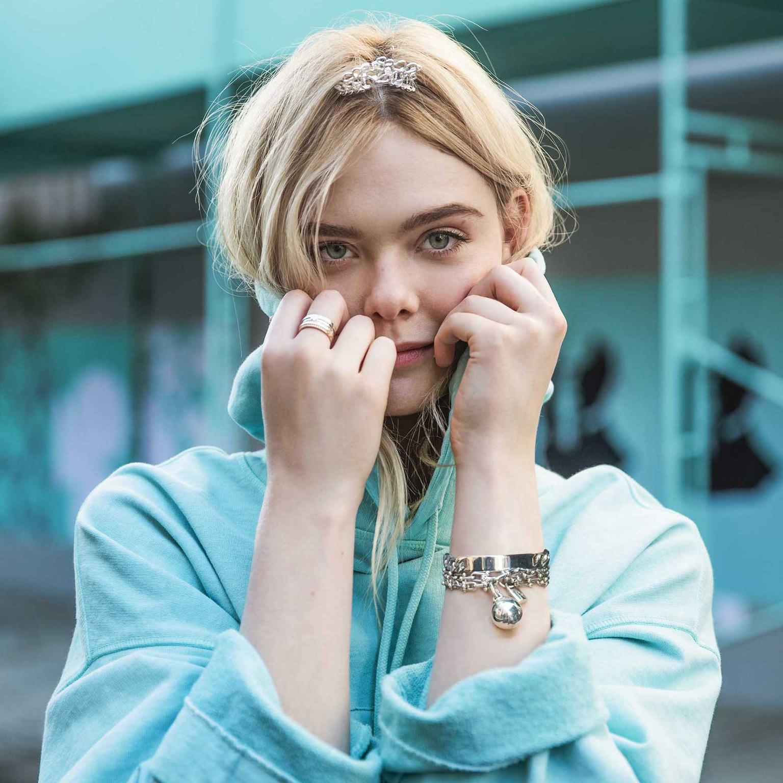 Elle Fanning is the star of Tiffany's new advertising campaign, and like Audrey Hepburn she wears a mini tiara