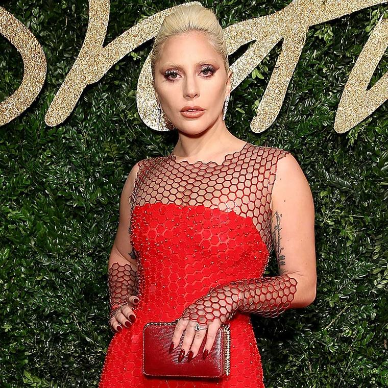 Lady Gaga in diamond Bulgari Serpenti earrings at the British Fashion Awards