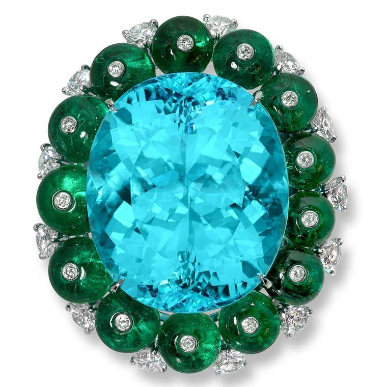 Moussaieff scarf clip with a 57.21ct Paraiba tourmaline 26cts of emeralds and 2.88cts of diamonds set in platinum.