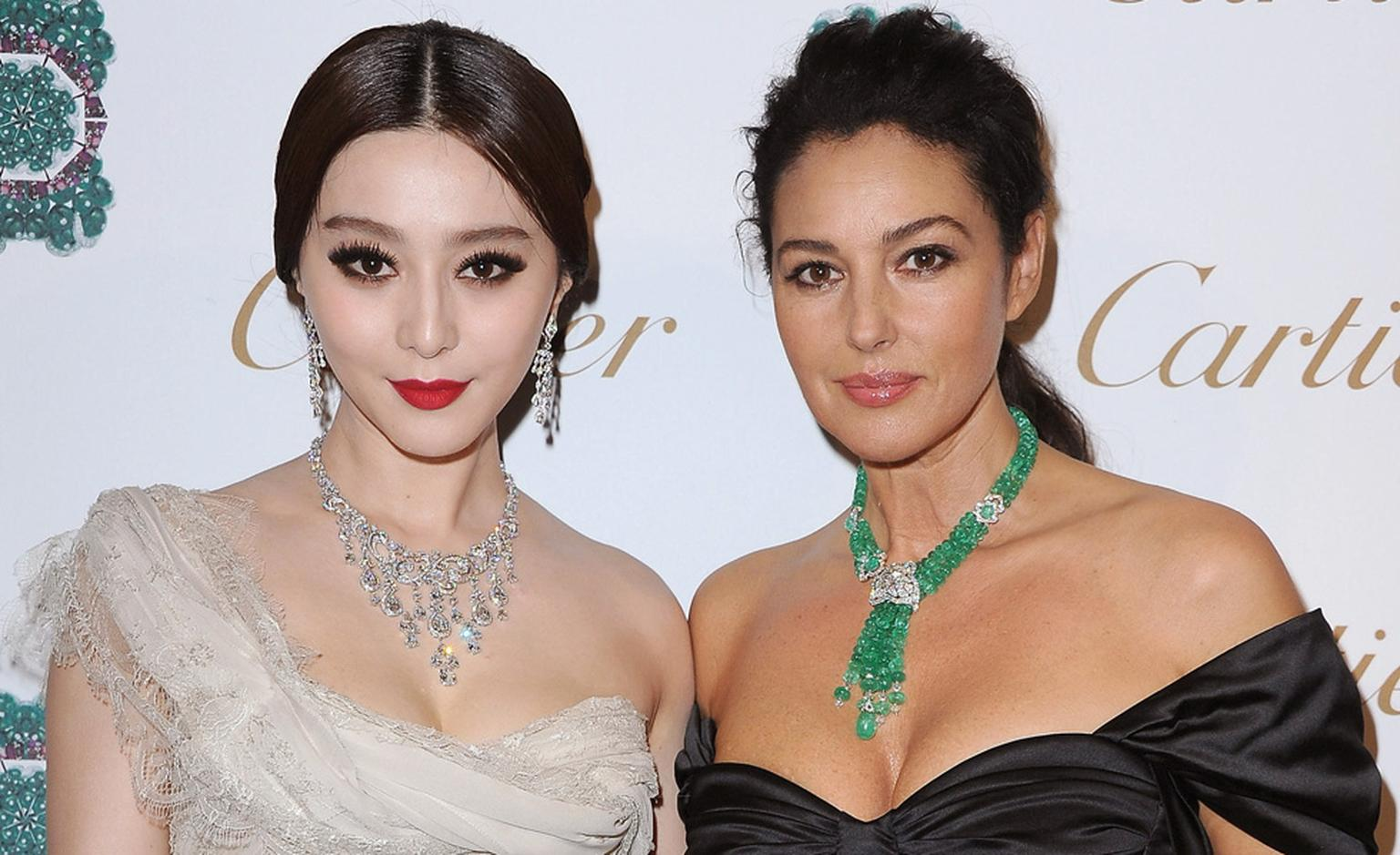 Fan Bingbing and Monica Belluci, a Cartier Ambassador, at the launch of  Sortilège de Cartier jewels in Rome.