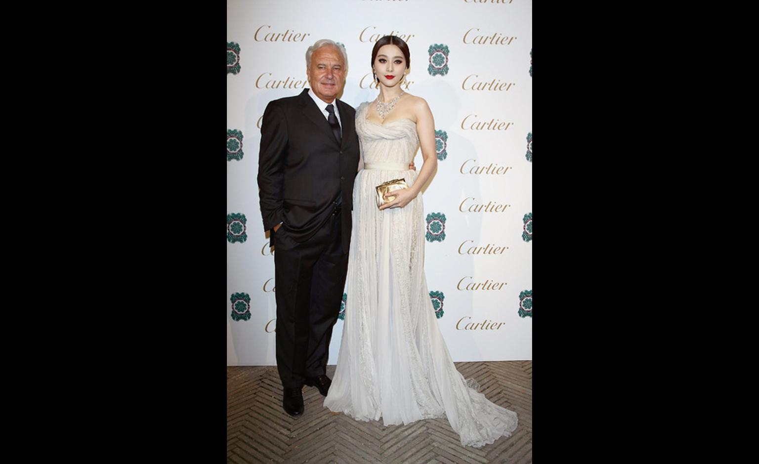 President and CEO of Cartier International, Bernard Fornas with Chinese singer and actress Fan Bingbing September 2011 at launch of Sortilège de Cartier jewellery collection.