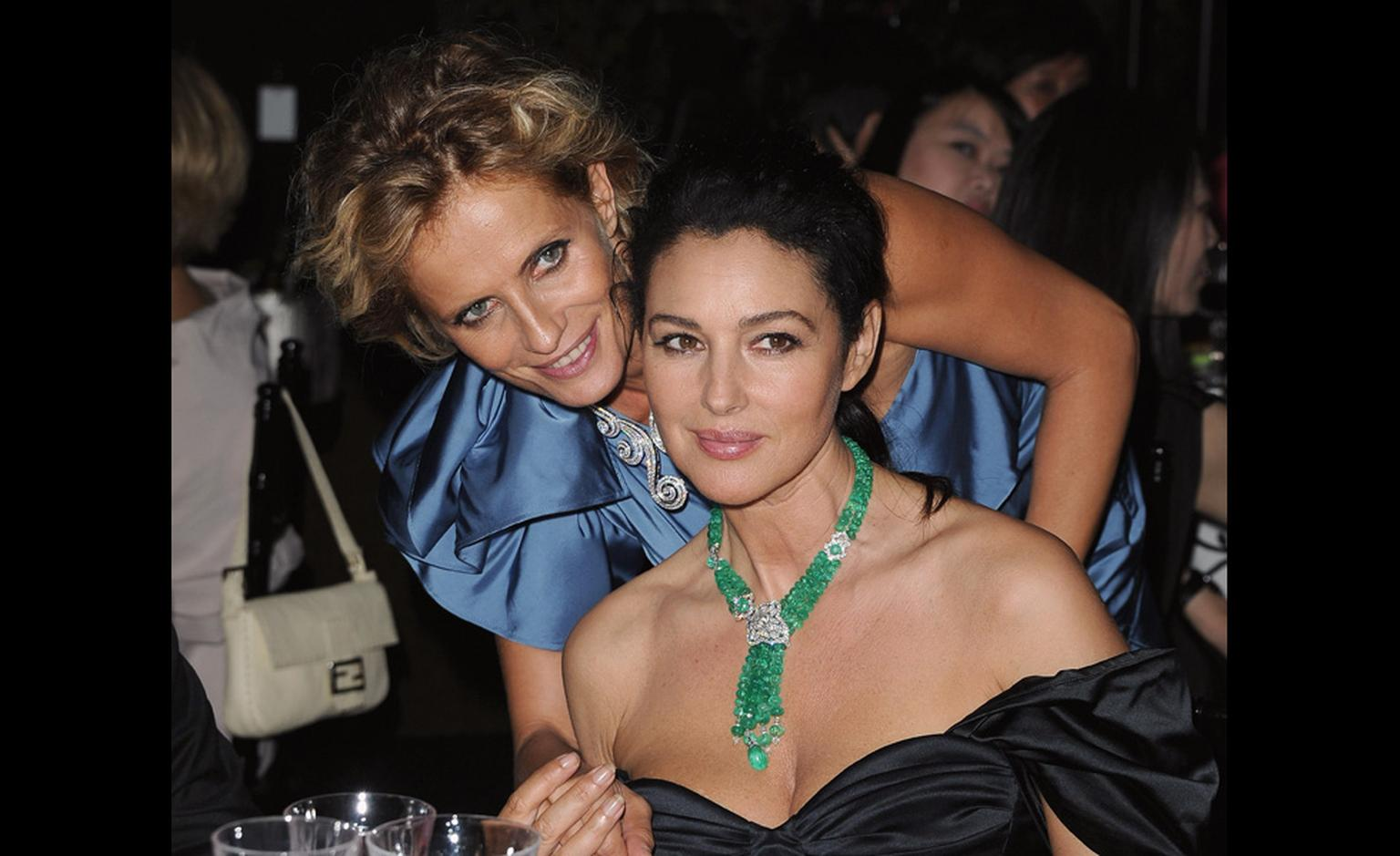 Isabella Ferrari with Monica Belluci at the dinner by chef Emanuele Scarello to celebrate the launch of Cartier's high jewellery collection.