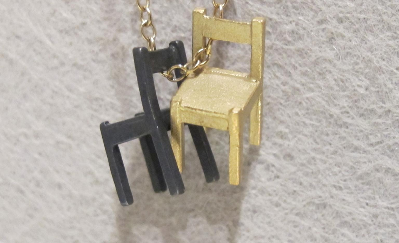 Zoe Arnold's very small chairs in gold and silver £560.