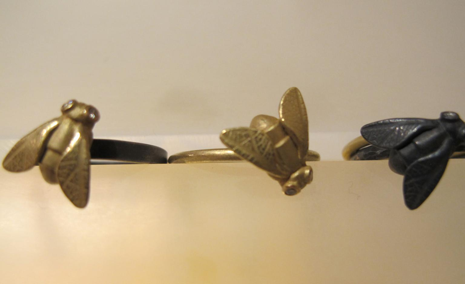 A small swarm of Zoe Arnold's Fly rings in gold and silver with diamond eyes from £295 in gold or £195 in silver.