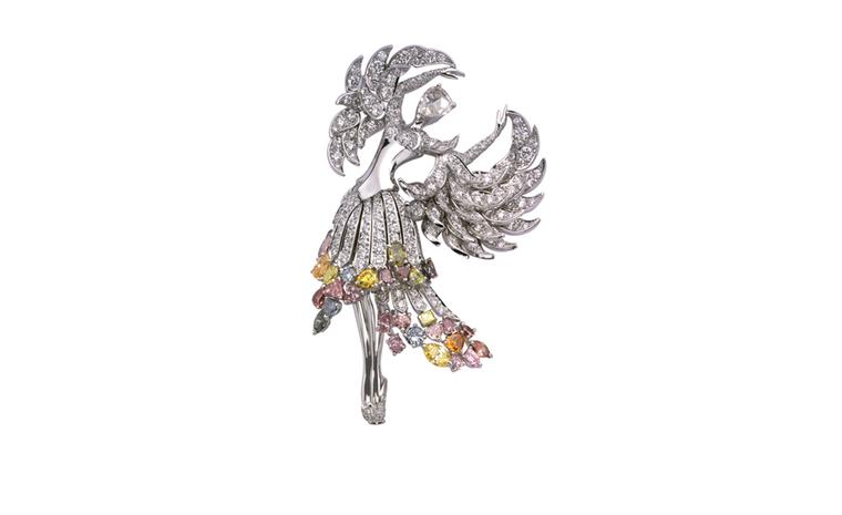 VAN CLEEF & ARPELS. Isadora clip in white gold, coloured diamonds, princess and rose-cut diamonds. POA