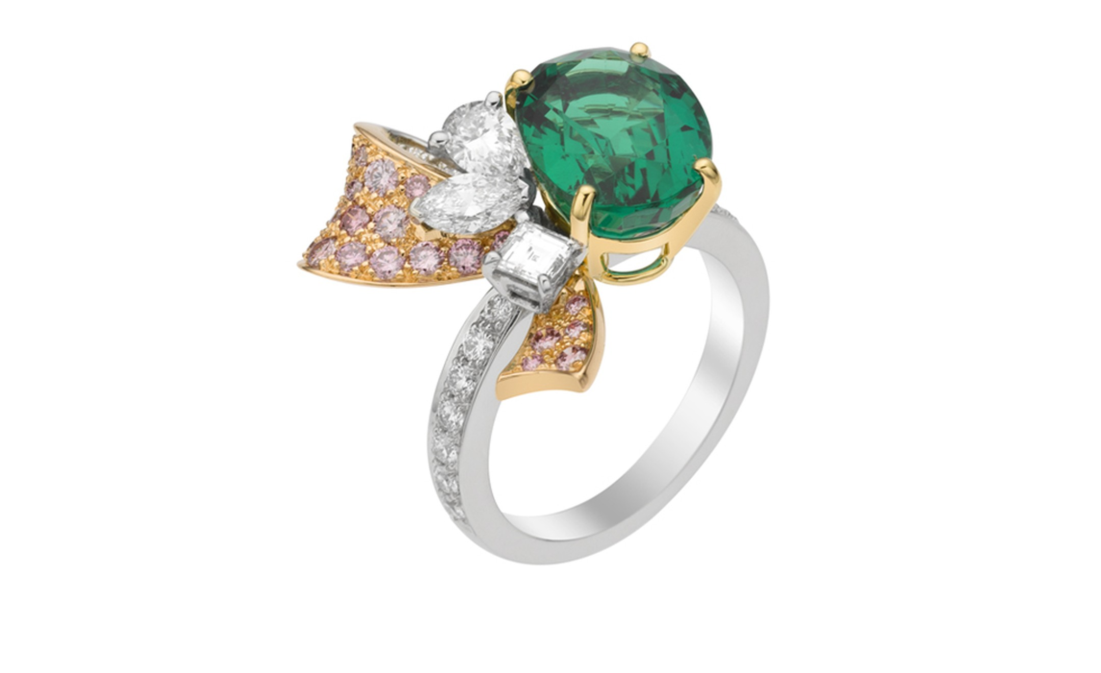 VAN CLEEF & ARPELS. Sonatine ring in platinum, pink gold, oval emerald, round pink diamonds and white diamonds.POA