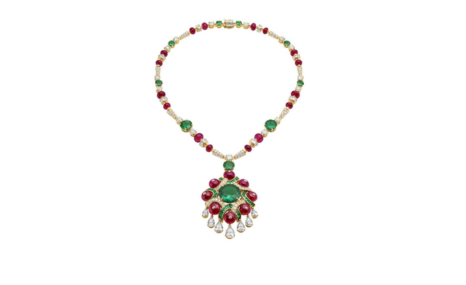 Bulgari. High Jewellery necklace in yellow gold with a Colombian emerald, 9 emeralds, 38 buff top emeralds, 24 spinel beads, 7 pea brilliant cut diamonds, 15 round cut diamonds, baguette diamonds and pave diamonds. POA.