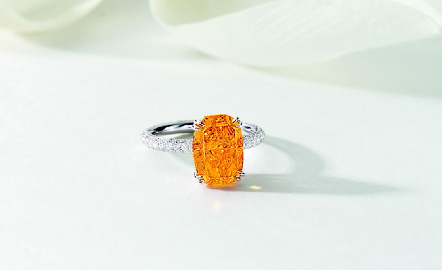 LOT 2669. Very rare and exquisite fancy vivid orange diamond ring. EST 19,000,000 - 23,000,000 HKD. LOT SOLD 23,060,000 HKD