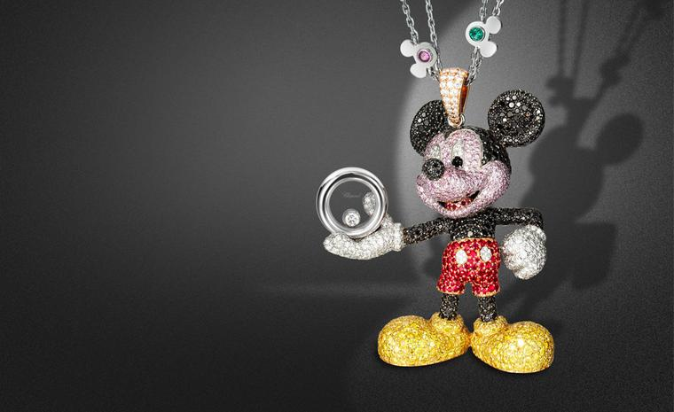 Happy Mickey pendant. In white, rose and yellow gold set with black, white, yellow and pink diamonds, rubies, onyx cabochons eyes, with one mobile diamond; on a white gold chain set with blue and pink sapphires, emeralds, rubies and amethysts. POA
