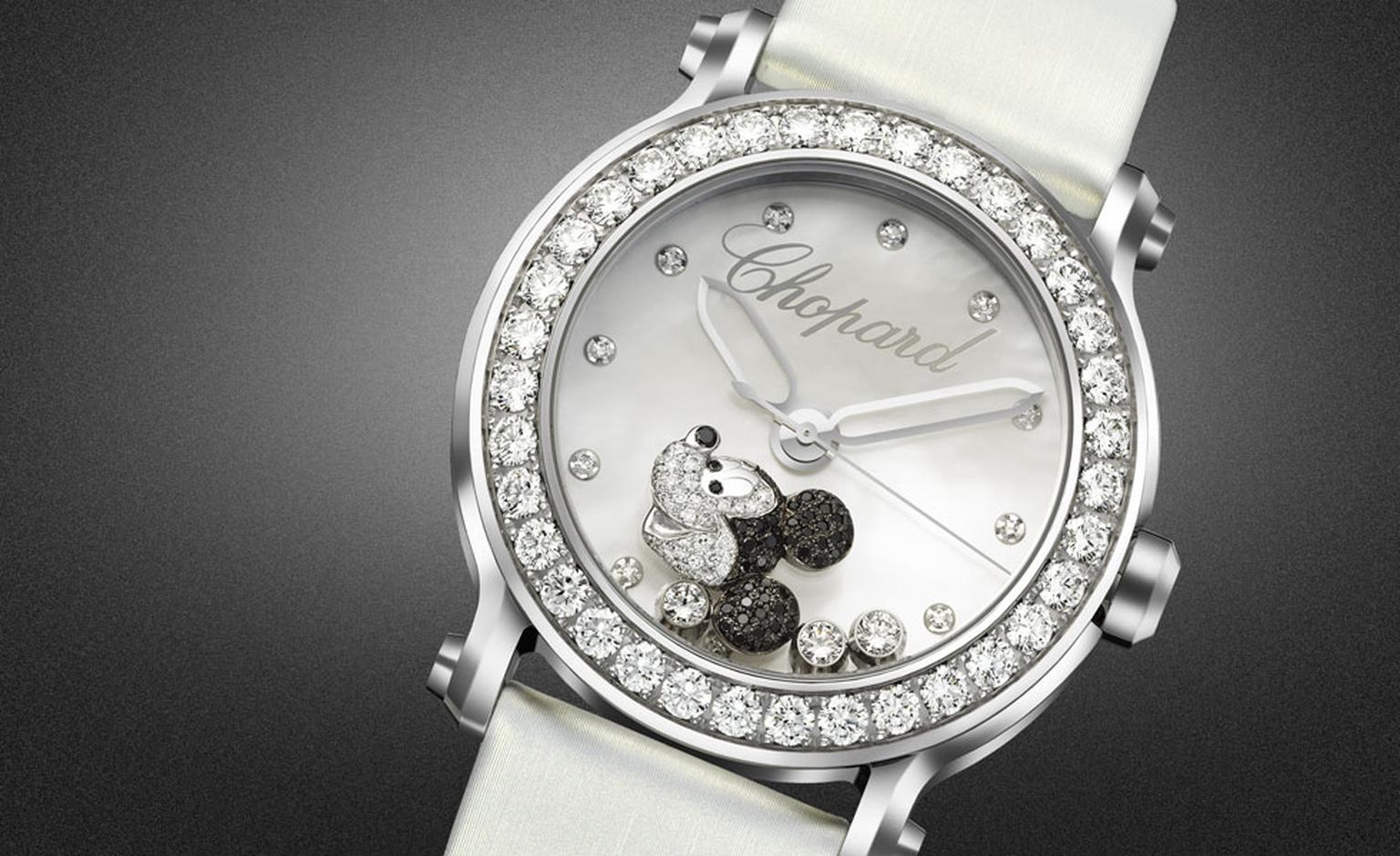 Chopard Happy Mickey watch in stainless steel with diamond set bezel, mother of pearl dial and a mobile Mickey set with black and white diamonds.