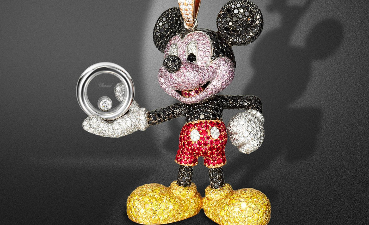 Close up of the Happy Mickey pendant sparkling with black, white and yellow diamonds - and a smart pair or ruby shorts.