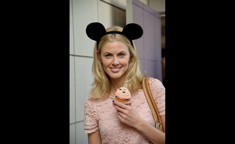 Donna Air dons ears before indulging in a cupcake at Chopard's launch of the Happy Mickey collection in London.