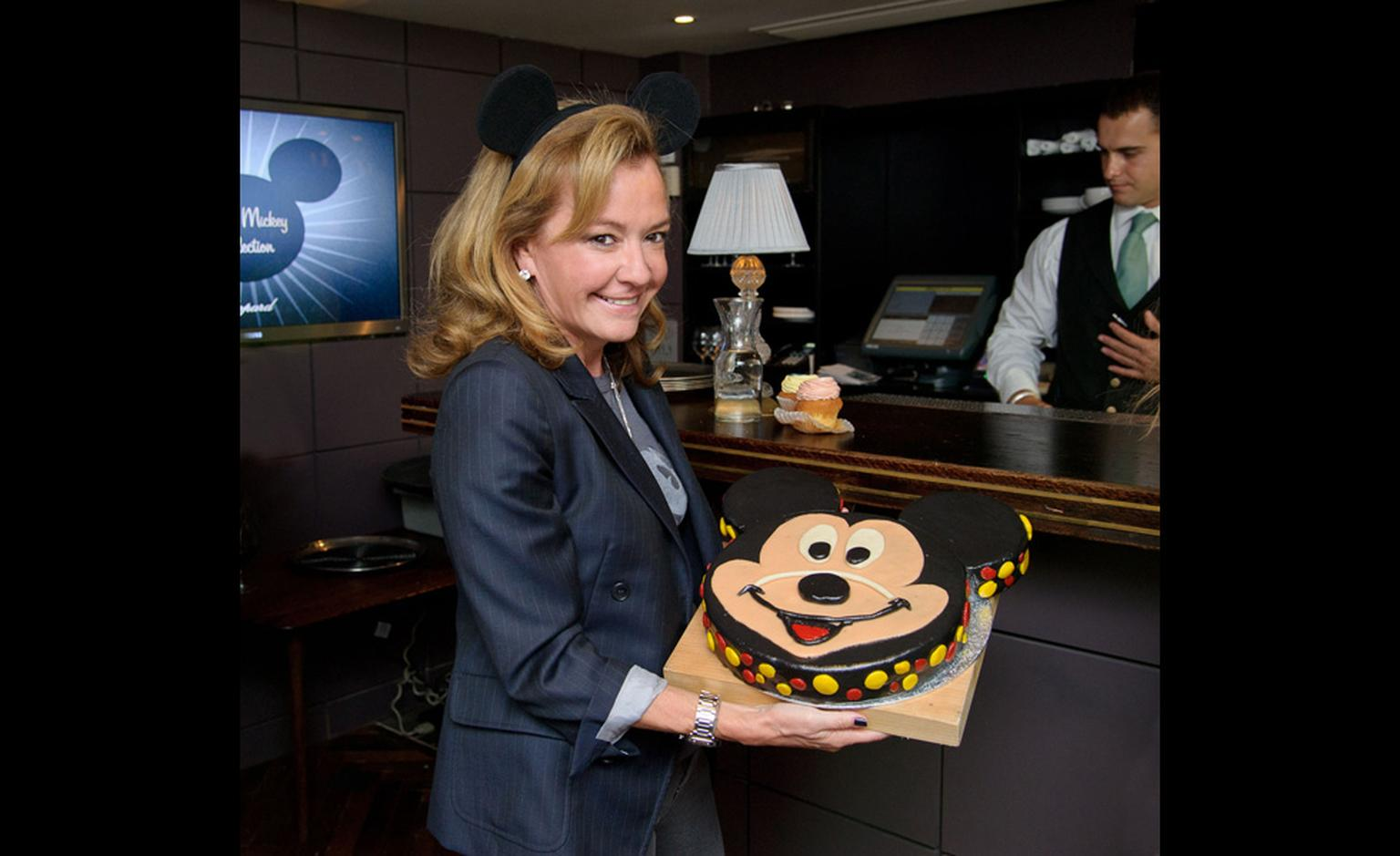 Caroline Scheufele, co-President of Chopard, with the giant Mickey Mouse brownie cake
