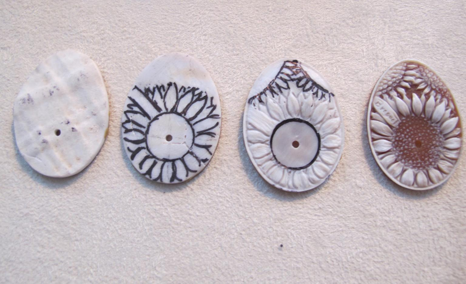 The stages of carving a dial from a shell cameo.