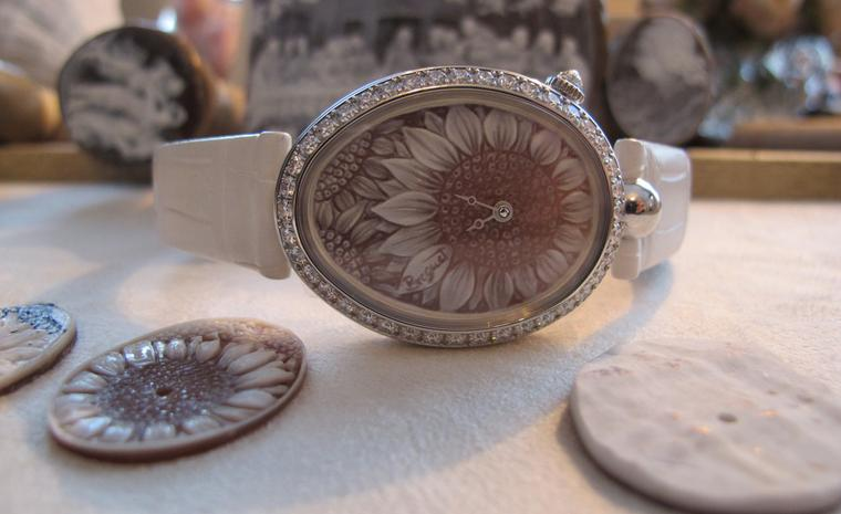 A finished Breguet Reine de Naples watch with a sunflower dial in cameo.