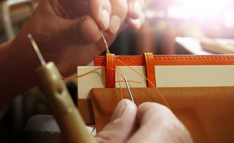 Once the leather has been cut and layered with the inner material and lining, it is sent to another workshop for stitching.