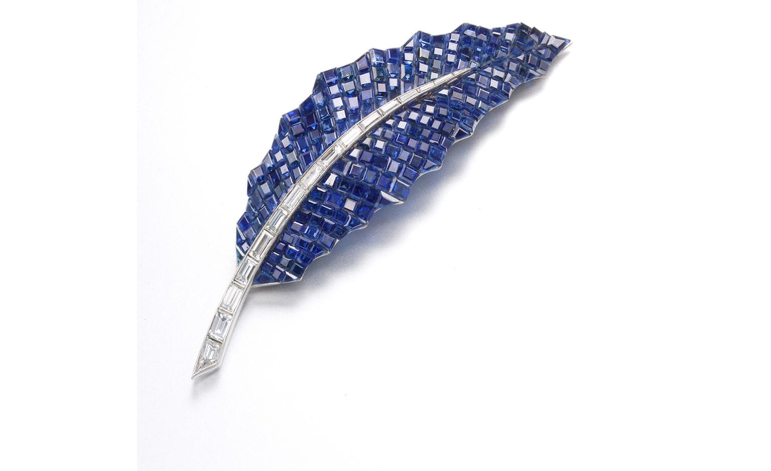 A Mystery-set sapphire and baguette-cut diamond 'Feuille de Houx'  brooch, by Van Cleef & Arpels, 1969. Estimate: SFr. 45,000-62,000 (US$ 50,000-70,000)
