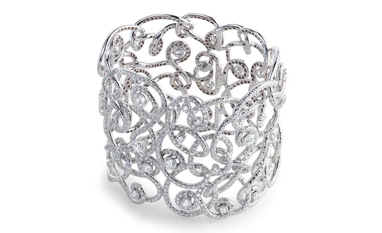 Fabergé Carnet de Bal Mazurka bangle, named for the dance fashionable during Fabergé Russia. Single diamonds are surrounded by swirling ribbons of gold and more diamonds. POA