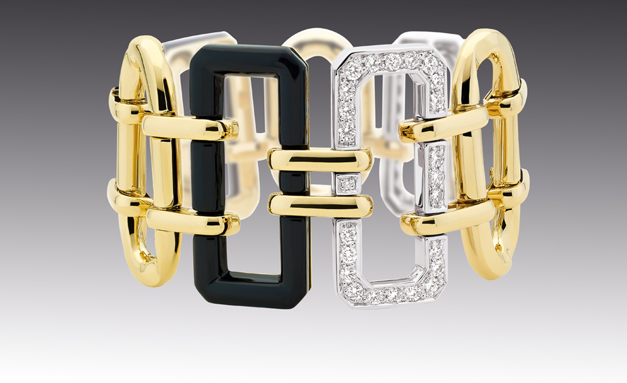 CHANEL, The Premiere cuff in 18kt white and yellow gold with onyx. £18,675