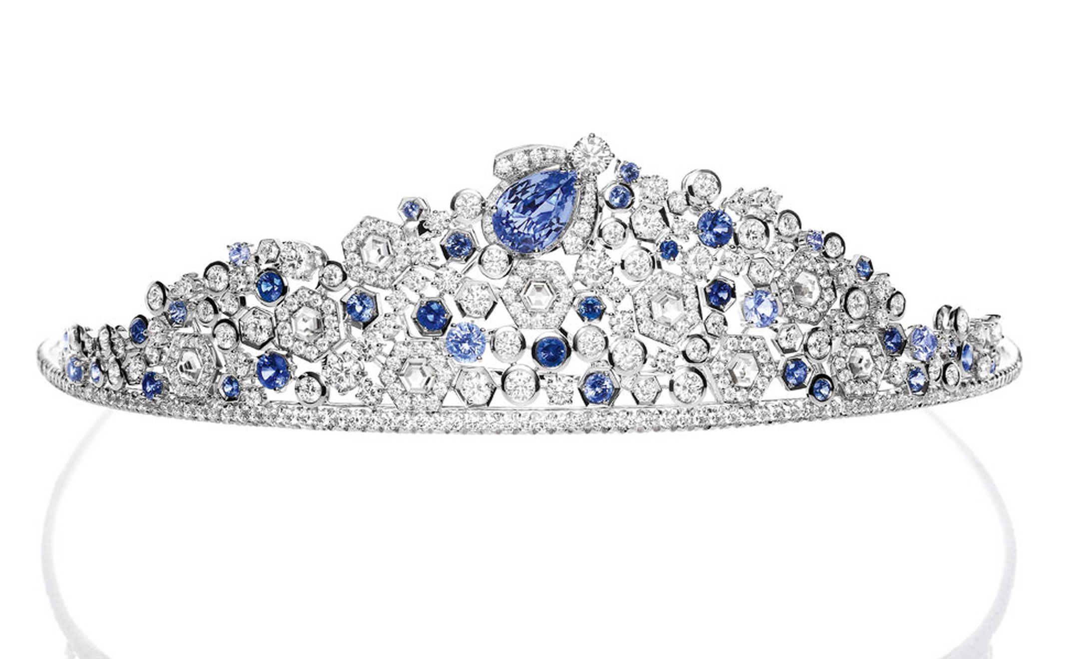 Chaumet's newest tiara - yes they are still making them - is the Bee My Love diademe that features buzzing blue sapphires bees busy with their diamond and white gold honeycomb. The central piece detaches and can be worn as a brooch.