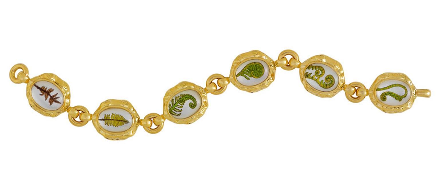 ELIZABETH GAGE, Crystal Fern Bracelet, rock crystal ovals, engraved and hand-painted showing the life cycle of a fern. Set in molten gold surrounds, with polished gold links. £15,000