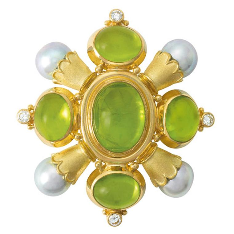 ELIZABETH GAGE, Kiss Pin, A gorgeous set of oval cabochon peridots, cultured akoya pearls in scallop edged gold funnels with diamonds and decorative gold bead detail. £15,600