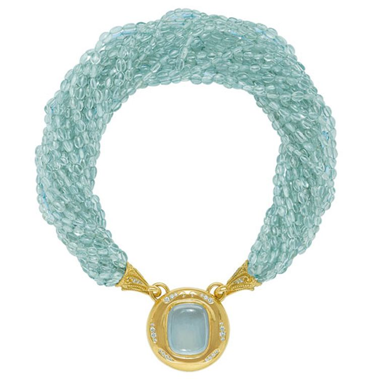 ELIZABETH GAGE, Aquamarine Neckalce Detachable pendant featuring a fabulous cushion-shaped cabochon aquamarine set in a gold and diamond surround, hanging from a multi-strand aquamarine bead necklace. The gold funnels are decorated with diamonds.POA