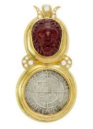 ELIZABETH GAGE, Arcadia Pin, this majestic Arcadia pin features a carved garnet lion head with a diamond crown set above an antique silver four pence coin, dating from the reign of Elizabeth I (1558-1603). The pin is decorated with diamonds. £11,400