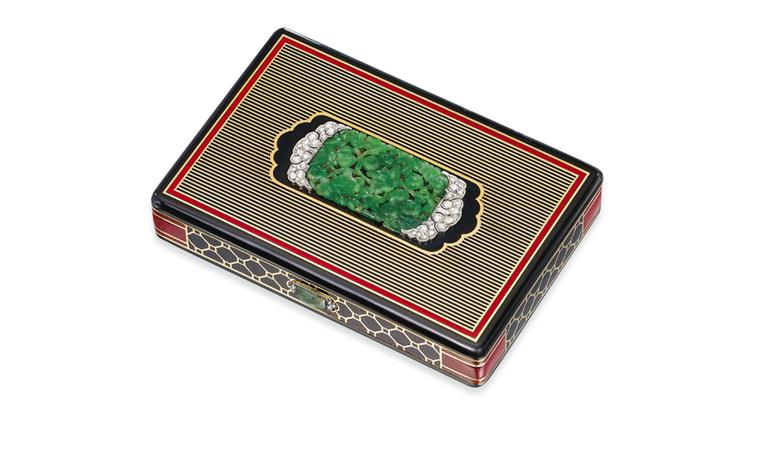 Lot 112. An art deco jade, diamond and enamel vanity case, by Cartier. Estimate £3,000-£4,000. SOLD FOR £27,500