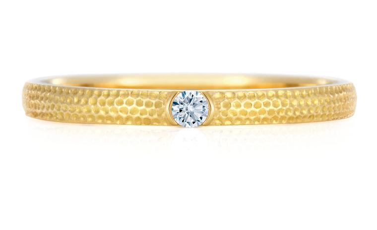 DE BEERS. Azulea Band, white diamond on yellow gold 0.03 carat weight. Price from £600.