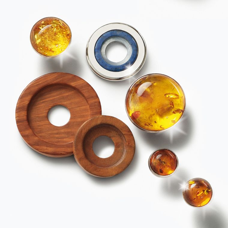 Charlotte Ehinger-Schwarz 1876. Baltic Colours. Earrings, pendants and rings with blue sapphires, fire enamel, stainless steel disc, faceted rock crystal over mother of pearl,  aquamarine, amber, bruyere wood.  All pieces sold separatley. Prices...