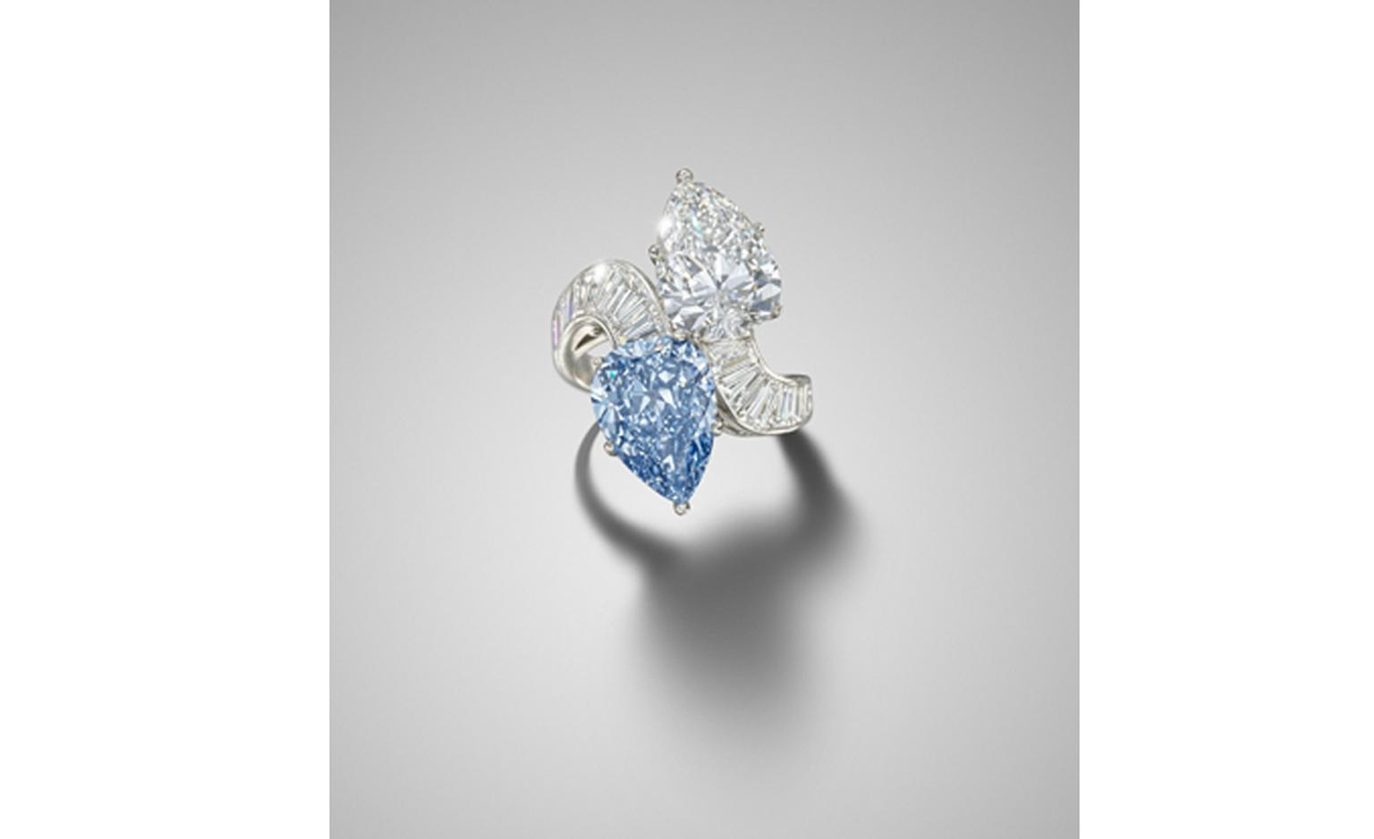 Lot 200. A diamond and blue diamond crossover ring,  by Bulgari. Estimate £600,000 - 800,000. SOLD FOR £1,889,250.