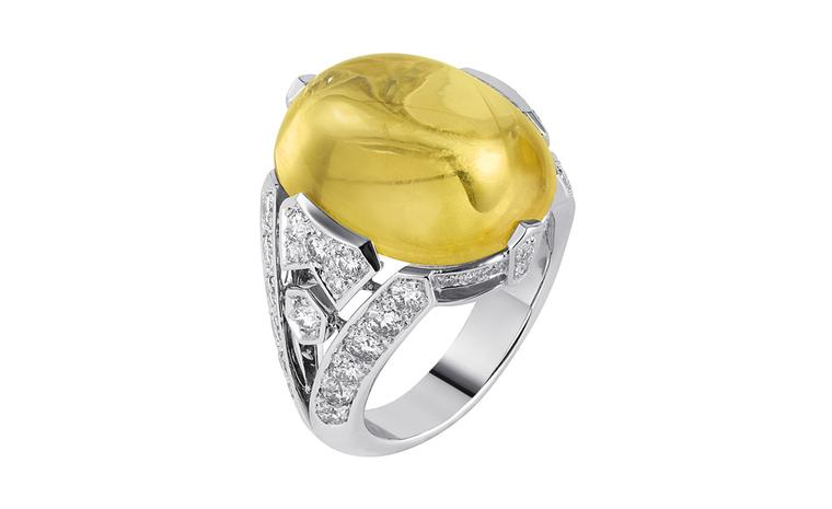 Sortilège de Cartier platinum ring with one cabochon-cut yellow sapphire with brilliant-cut diamonds.